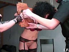 Nasty brunette French granny gets hung up and painfully tortured before she's ass fisted and fucked by big cocks and toys in this free amateur sex video.