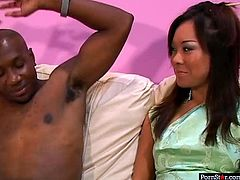 Exotic bitch stands on her knees and gives one BBC eager blowjob. She makes his long huge black cock stiff and sucks it with a great delight.