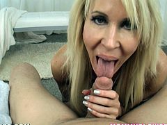 This kinky and desirable milf Erica Lauren is making some love on a big cock! Honey loves sucking huge dicks and here is how she does it for some cum!