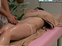Here's one naughty Asian brunette belle ready to get her clam oiled and massaged by a kinky masseuse who knows how to arouse her.