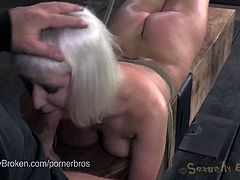 Here's some hot blonde and brunette slaves getting their mouths and pussies banged in the dungeon after getting bound. These intense bitches love feeling their master's black and white cocks.