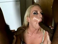 Nasty Simone Schiffer sucks two big black cocks. After that she gets double penetrated and facialed. It is the best sex in her life.