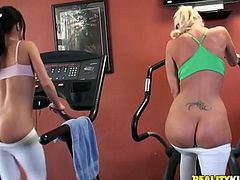 A blonde and a brunette have a training session in the gym. After some time they take their clothes off and lick each others pussies in a 69 position.