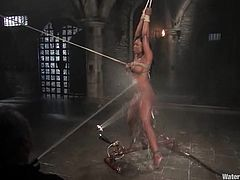 Busty ebony chick Jada Fire is having a good time with some dude in a basement. She allows him to tie her up and then gets drowned and fucked hard with a dildo.