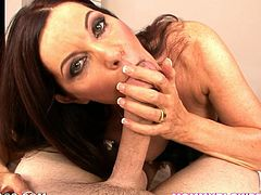Sexy dark-haired mom Magdalene St. Michaels strips and shows her ass and tits to the guy. Then she kneels in front of him and sucks his cock till it explodes with jizz.