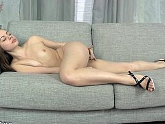 Charming pale brunette SASHA is busy with fingering her holes on the couch
