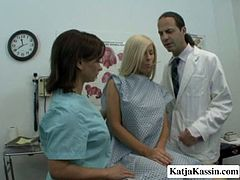 Sexy blonde girl with silicon tits Katja Kenzie is seduced by Eric in Doc's office