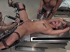Two sweet nurses do some rough things with blonde girl
