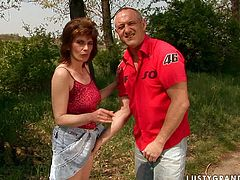Kinky redhead bitch with chunky body is walking in the forest with her man. Then she gets down on her knees and takes her lover's cock in her mouth. She gives him stout blowjob outdoor.
