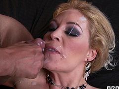 Amazing cougar with big tits and sexy stockings receives a fat cock in her warm vag