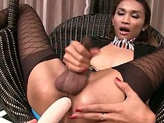 Nok is a slender Asian tranny. She it stroking her cock and, at the same time, a guy is toying her ass hole.