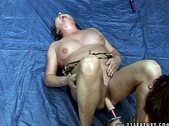 Chubby mom is toy fucked in the beginning of the porn session. Then handsome perverted guy stands on his all four serving his ass to slutty bitch. She polishes his ass hole properly. Later he drills her cunt with screwer with dildo head.