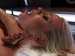 Lorelei Lee and Isis Love are having some fun together. Isis rubs Lorelei's vag with a dildo and then makes the blonde ride a fucking machine.