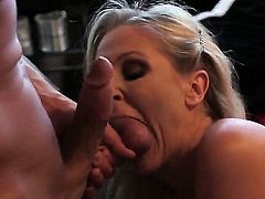 Smoking hot blonde milf Julia Ann with stunning curves and big round bums in black stockings suck balls and huge cock before tall Bill Bailey fucks her hard in living room.