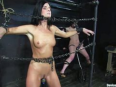 Evil things happen in this dark room. Two brunettes are chained and humiliated by a very skillful executor. He takes his time and does things by the book. The whores have dildos that are filling their cunts from down to up, heavy chains that keep them immobilized and they scream desperately. Enjoy!