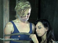Maia Davis is a tall blonde slave ready to be tied and gagged by the petite brunette mistress Elise.