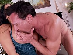 Utterly steamy Latin hottie with big enhanced tits squats down in front of macho dude to give him a skillful blowjob before she tops his massive cock for a ride in cowgirl style.