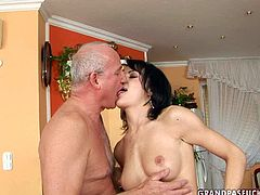 Tasty looking brunette MILF in seductive black lingerie shows off her steamy body to aroused grey-haired dad before she goes down to give his oversized penis a blowjob while fingering her bald vagina.
