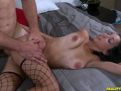 Mia Hurley is a sexy Latina dressed in fishnets and heels only. She gets screwed by a muscular guy on the bed.