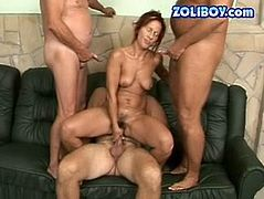 Small titted mature woman is riding big hard cock while sucking two dripping sticks one after another. This voracious bitch is brutally screwed in gangbang session. She deserves to be punished.