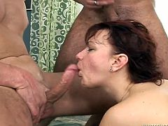 Ruined brunette mom with slack tits makes out with 3 fuckers at a time. She lies on her back getting fucked missionary style while giving double mouth fuck before switching to cowgirl style in gangbang sex orgy by Fame Digital.