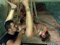 Divine Russian hottie gives a head to strain dick being hanged to the ceiling