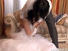 This Japanese woman has just got married to a guy she doesn't love. She had to do it because her father wanted so. This awful Japanese groom takes more than just her last name, he takes her virginity. She struggles but he makes her get on her knees and suck his cock until he is satisfied.