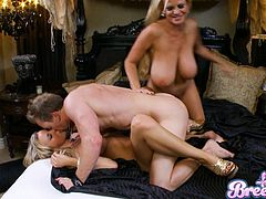 Alluring blondes with huge tits are having the same cock fucking themr hard in threesome
