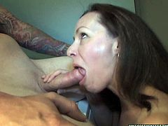 Brownhead wench with skinny ass and small tits is sitting down on her knees sucking meaty stick deepthroat. She also gives titjob to her lover.