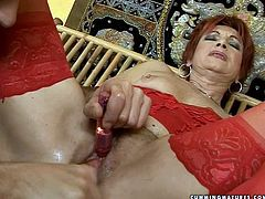Steamy red-haired granny enjoys getting her wet hairy pussy dildo fucked and her tickled stimulated with vibrator as she sits in front of perverse daddy with legs wide open in sultry sex video by 21 Sextury.