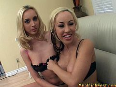 Two ruined blond sluts with heavy make up in raunchy lingerie sit on the couch flirting with cam before one of them stands in doggy pose to get her pussy polished by another slut.
