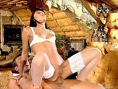 Beautiful brunette Kathy Divan wearing white lingerie and stockings is getting naughty with some dude indoors. She favours him with a blowjob and then welcomes his prick in her cute butt.