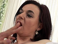 Ample brunette overaged hussy hooks up with a kinky dad. He strokes her vagina with hands before she goes down on her knees in front of him to mouth fuck his strain dick.