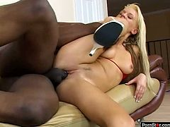 Appetizing blonde gets her pussy drilled hard in missionary style from behind by one horny black stud. At the end naughty blonde opens her mouth wide to get cumshots.