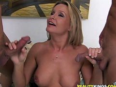 Slutty blonde chick gets her titties licked by two dudes. After that she gives them hot blowjob and gets her shaved pussy fucked hard.