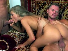 Sexy long-haired blonde Cayenne Klein shows her small tits to two men and pleases the guys with a blowjob. Then the studs fuck Cayenne's pussy and ass at the same time and enjoy the way she moans with pleasure.