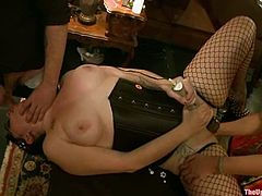 Hot chicks with big boobs and asses get tied up. Later on they fuck each other with a strap-on and fist their pussies.