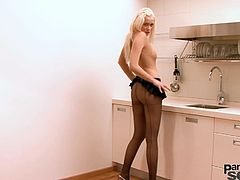 Cute blonde likes to rip her sexy pantyhose while masturbating her shaved twat