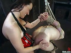 Adorable brunette chick in latex corset ties James up and then stuffs his ass with a strap-on from behind. After that she also toys herself with a vibrator.