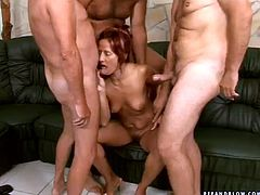 This woman is the kind of girl that needs to be fucked hard. Fortunately for her we have volunteers for that kind of thing! Dirty whore gets her pussy filled with cock but she has two more cocks to handle in this hot gangbang scene.