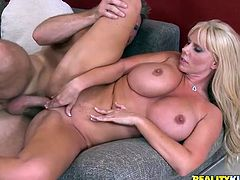 The big boobed cougar, because she's not a MILF, she's a cougar, Karen Fisher, is titty fucking and enjoying hardcore sex.