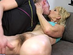 Kinky dude fondles one grannie with pleasure. He kisses her saggy nipples and dives in her hairy ugly pussy to make her orgasm.