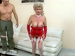 Flamboyant red-haired granny in raunchy red lingerie and white stockings bends over a couch allowing a rapacious dad pound her oversized cunt with a dildo drill in sizzling hot sex video by 21 Sextury.