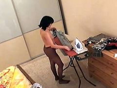 Make sure you check out this hot spy cam installed in a hotel room! Young chick is ironing her clothes only in her tights!