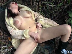 Check a busty and provocative brunette slut flaunting her big natural tits and hot ass while masturbating in the forest.