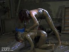 This dominant Asian chick forces her slave to get full of mud and drags her through it, torturing her.