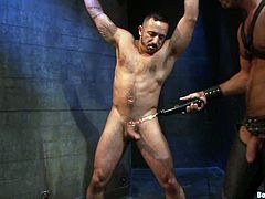 Alessio Romero and Damien Stone are having some fun in a basement. Alessio binds Damien, beats him and then drills his butt with his schlong.