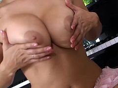 Brunette with big tits Sunny Leone loves to pose when masturbating her wet twat