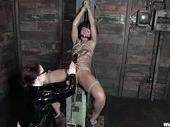 There's some extreme bondage in store for Jandi Lin who will be dominated by Claire Adams in this lesbian femdom video with toying and torture.