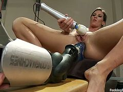 Hot chicks gets their asses stuffed by a machine in sports hall